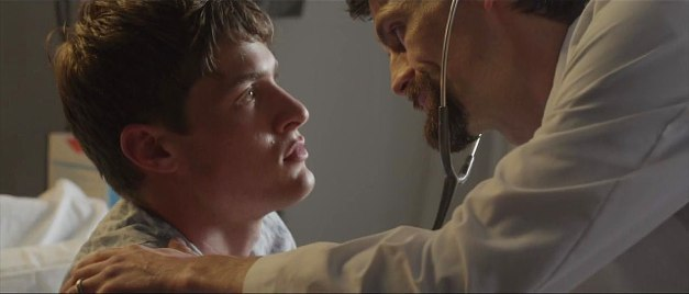 Pictured: After a near-fatal accident, Keegan Dark (Blaise Embry) is examined by a doctor (Andy Copeland) who may not have Keegan's best interests at heart.
