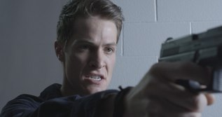 Keegan Dark (Blaise Embry) takes aim in this still from 'The Dark Place.'